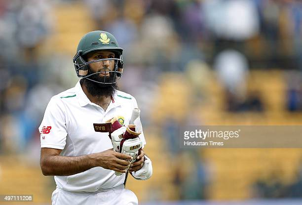 South African player Hashim Amla leaving the ground after dismissed by Indian cricket team player Varun Aaron during the 2nd Test match between India...