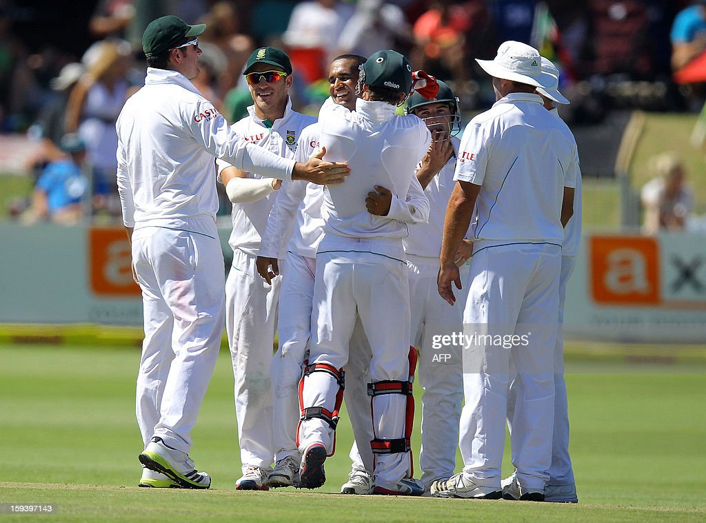 South African players celebrate on January 13, 2013 the wicket of Kane Williamson of New Zealand on the third day of the second and final test match between South Africa and New Zealand at the Axxess St George's Cricket Stadium on January 13, 2013 in Port Elizabeth. AFP Photo / Anesh Debiky