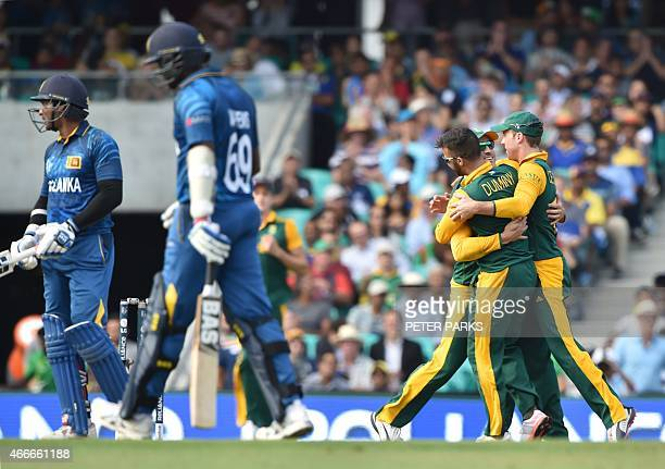 South African players celebrate taking the wicket of Sri Lanka's Angelo Mathews during the 2015 Cricket World Cup quarterfinal match between South...