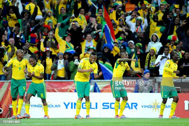 South African players celebrate their goal scored by Siphiwe Tshabalala during the 2010 FIFA World Cup South Africa Group A match between South...