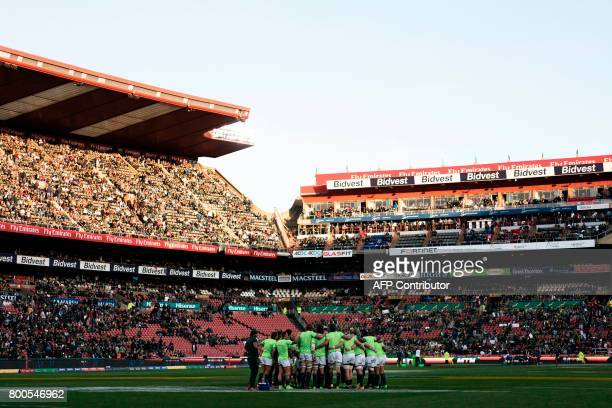 South African players form a huddle ahead of the third rugby union Test match between South Africa and France at The Emirates Ellis Park Stadium in...