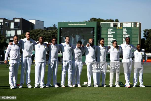 South African players sing the national anthem during day one of the Test match between New Zealand and South Africa at Basin Reserve on March 16...