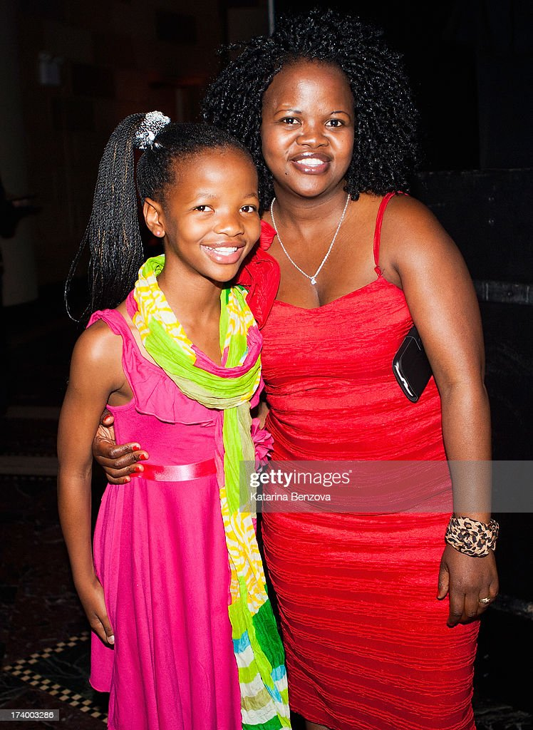South African poet Botlhale Boikanyo and mother pose at The Nelson Mandela Legacy Of Hope Foundation Event at Gotham Hall on July 18, 2013 in New York City.