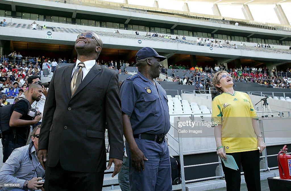 South African Police minister Bheki Cele (C) and <a gi-track='captionPersonalityLinkClicked' href=/galleries/search?phrase=Helen+Zille&family=editorial&specificpeople=869313 ng-click='$event.stopPropagation()'>Helen Zille</a>, the mayor of Cape Town watch the practise run at the soccer stadium on April 29, 2010 in Cape Town, South Africa. The practise was being held ahead of the Fifa Soccer World Cup 2010 which will be held in South Africa in June 2010.