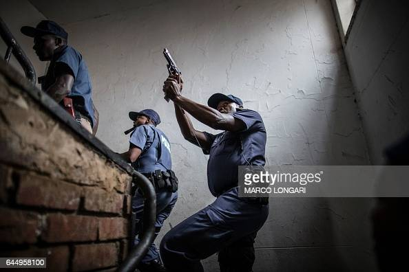 TOPSHOT South African police officers raid a building where alleged foreign drug dealers hide in Pretoria on February 24 2017 South African police...