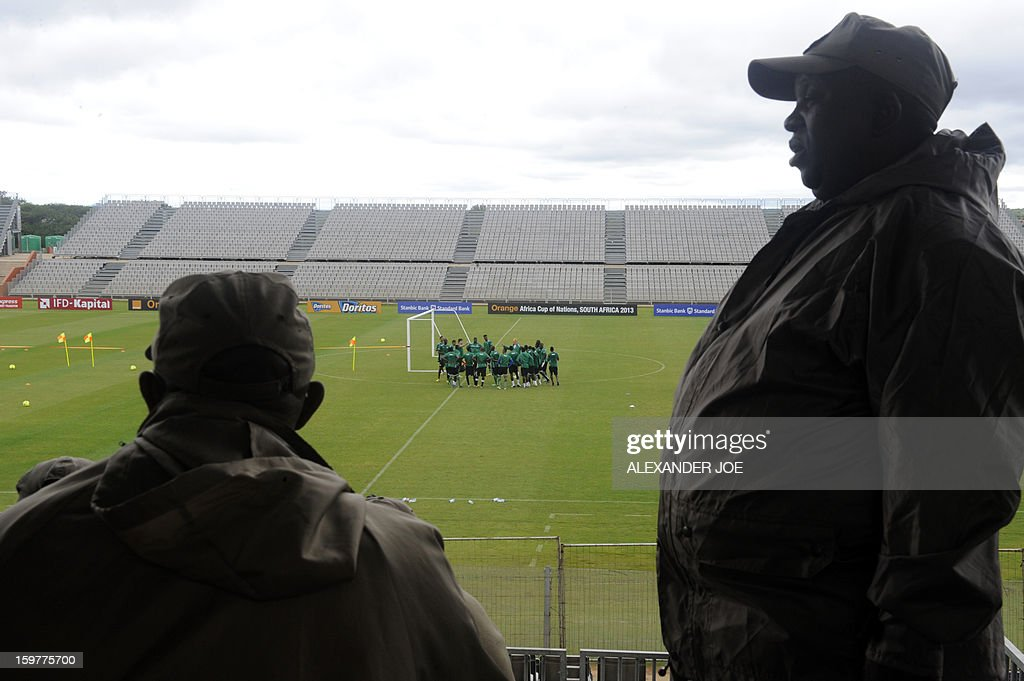South African police officers stand guard as Togo team players take part in a training session in Moruleng on January 20, 2013, at the Moruleng Stadium. Togo will play their first Group D 2013 Africa Cup of Nations match against Ivory Coast on January 21.