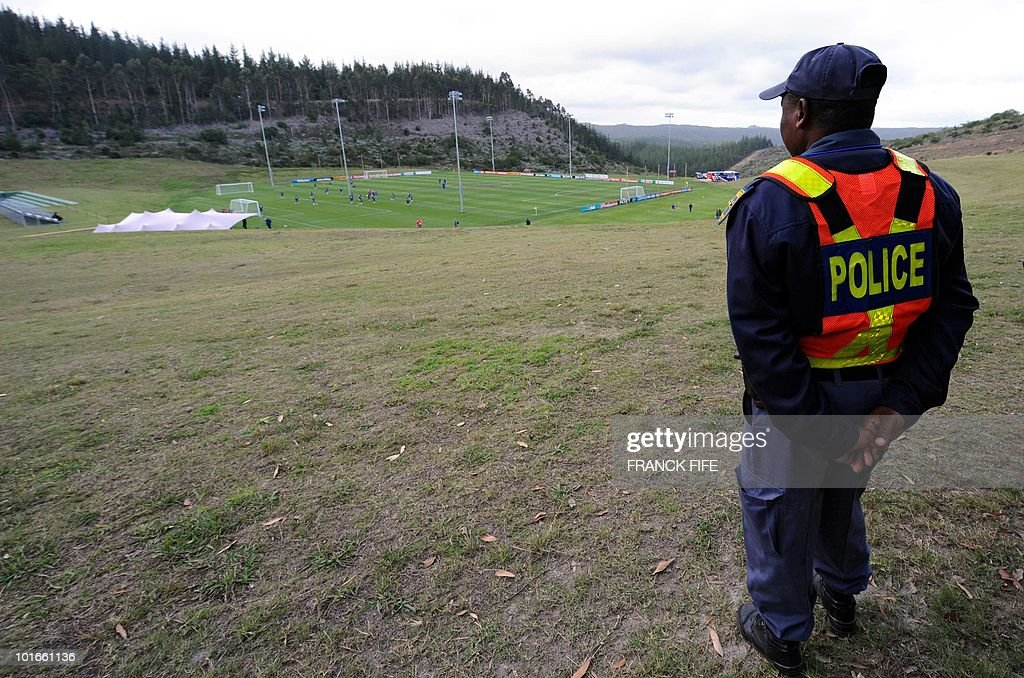 A South African policeman stands guard during a training session of the French national football team in Knysna on June 6, 2010 ahead of the start of the 2010 World Cup football tournament.