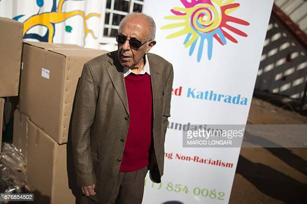 South African politician former political prisoner and antiapartheid activist Ahmed Kathrada takes part in a charity activity for Nelson Mandela Day...