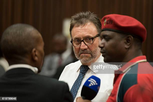 South African Politician James Selfe and Godrich Gardee of the Economic Freedom Fighters party speak during the case of the public protector vs the...