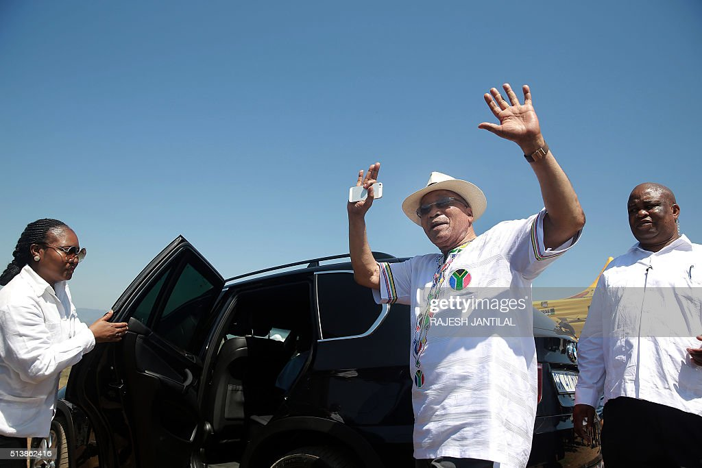 South African president and leader of the ruling African National Congress party Jacob Zuma cheers voters who register at the Ntolwane Primary School...