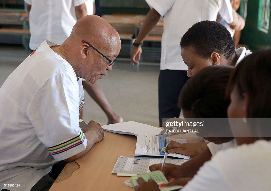 South African president and leader of the ruling African National Congress party Jacob Zuma checks his registration with Independent Electoral...