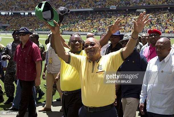 South African President Jacob Zuma and Deputy President Cyril Ramaphosa wave at the crowd as they arrive to attend South Africa's ruling African...
