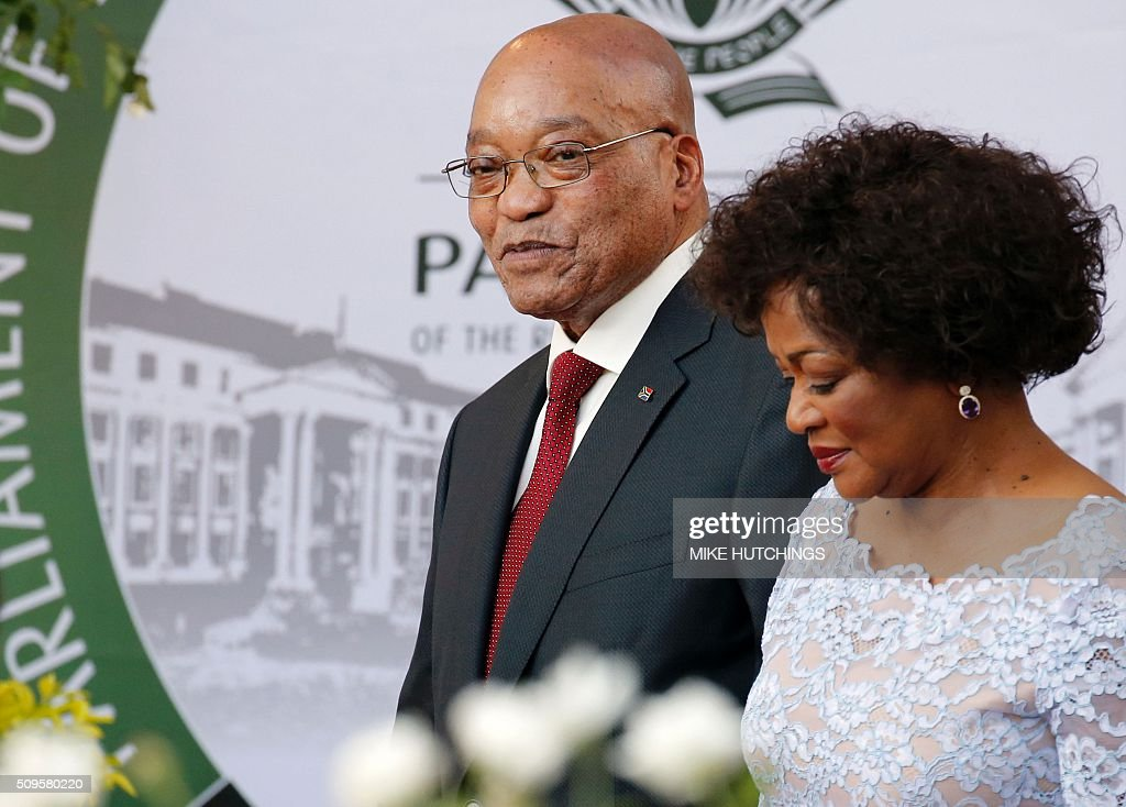 South African President Jacob Zuma (L) and National Assembly speaker Baleka Mbete (R) arrive for the President's State of the Nation Address on February 11, 2016 in Cape Town. South African President Jacob Zuma delivers his annual state of the nation address on February 11, 2016 as frustration grows over his leadership and the country's lack of progress since apartheid ended more than 20 years ago. Zuma's critics accuse him of allowing a small black elite to enrich itself, failing to help the poor, and overseeing national economic decline as South Africa struggles to overcome the legacy of decades of white-minority rule. / AFP / POOL / Mike HUTCHINGS