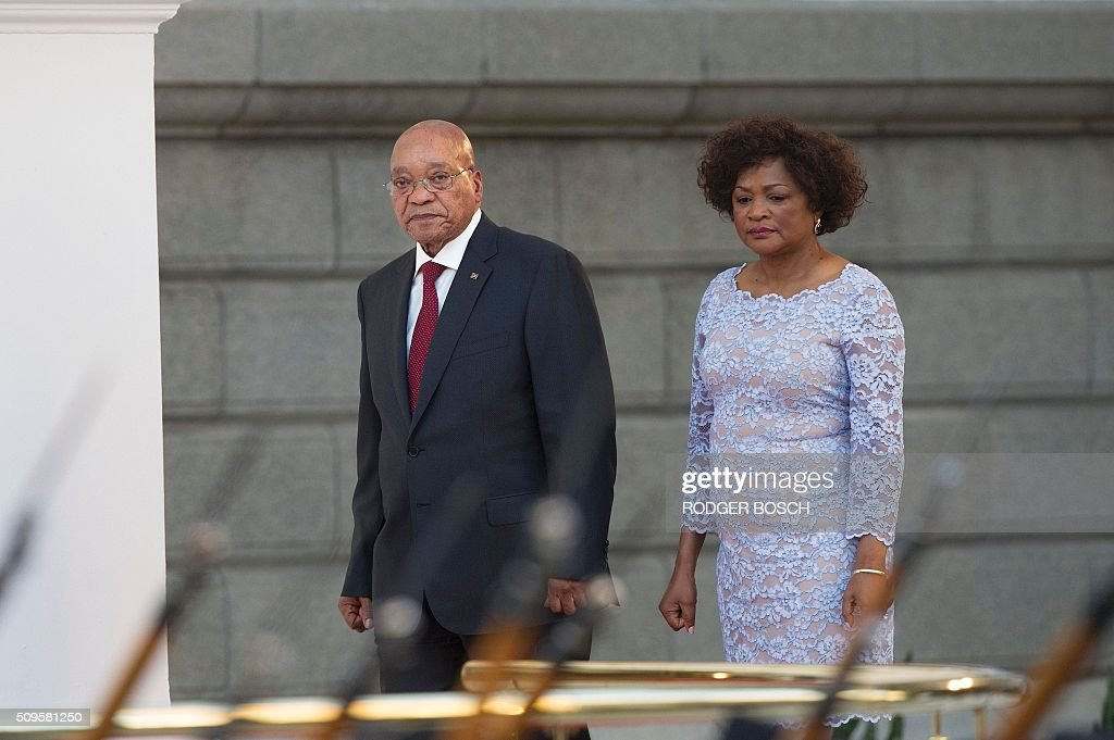 South African president Jacob Zuma (L) and National Speaker Baleka Mbete (R) arrive for the President's State of the Nation Address on February 11, 2016 in Cape Town, South Africa. / AFP / RODGER BOSCH