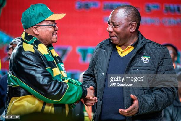 South African President Jacob Zuma and South African Deputy President Cyril Ramaphosa shake hands as they arrive to attend the opening session of the...