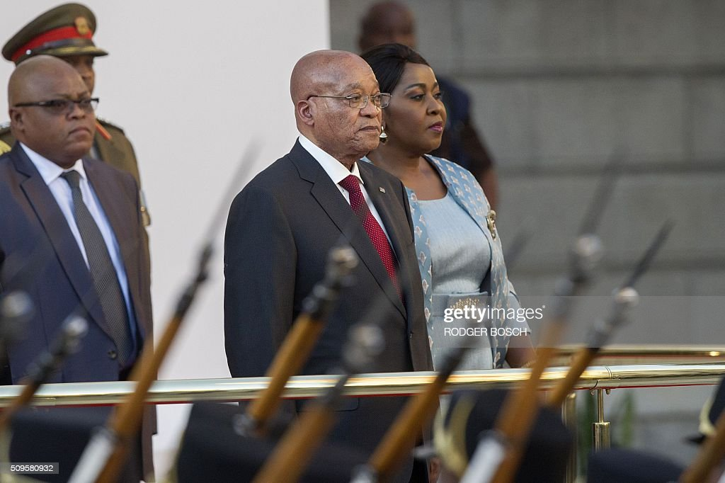 South African president Jacob Zuma (L) arrives for the President's State of the Nation Address on February 11, 2016 in Cape Town, South Africa. / AFP / RODGER BOSCH