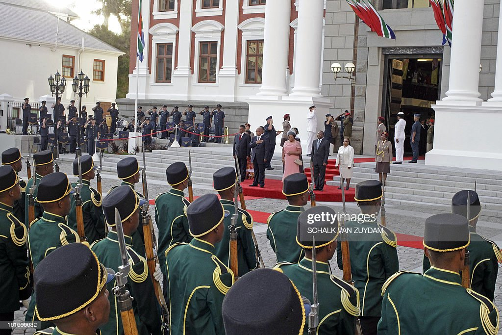 South African president Jacob Zuma, centre back, salutes a guard of honour forming part of the South African Parliament opening in the city of Cape Town, South Africa, on February 14, 2013.