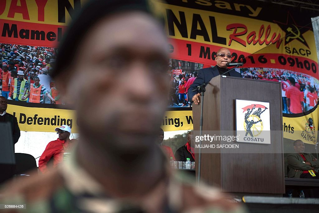 South African President Jacob Zuma (R) gives a speech during the congress of South African Trade Unions (COSATU) as part of the May Day rally at Mamelodi's Moreleta park on May 1, 2016 in Pretoria. Secretary General Sdumo Dlamini, South African Communist Party leader Blade Nzimande and Zuma took part in the rally. / AFP / MUJAHID