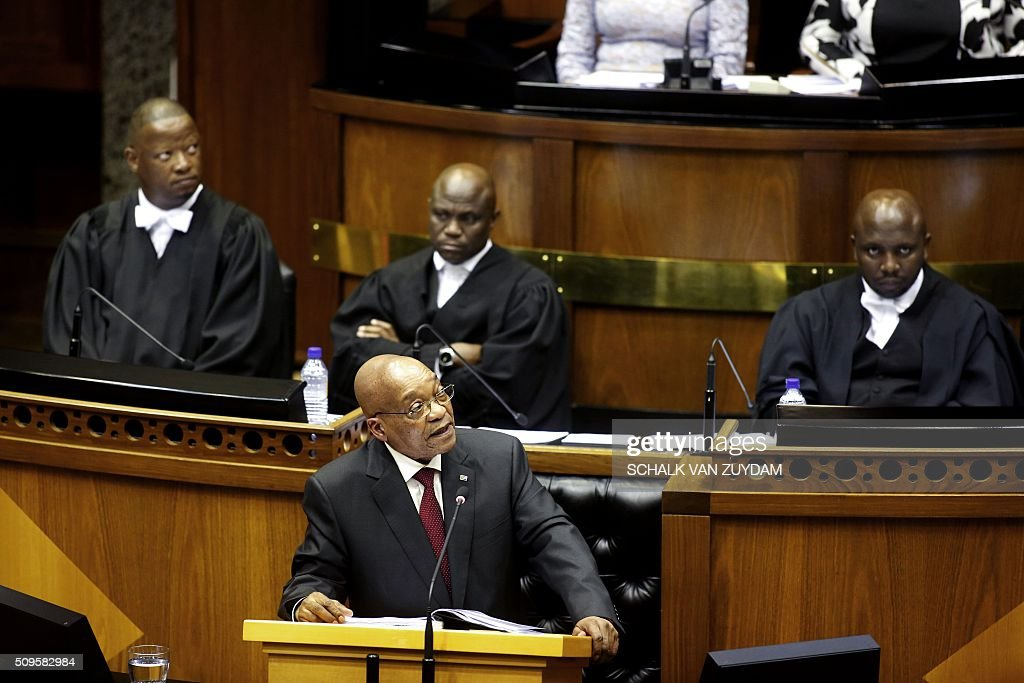 South African President Jacob Zuma (C) gives his sate of the nation address in Cape Town, South Africa, on February 11, 2016. South Africa's radical leftist Economic Freedom Fighters (EFF) party walked out of President Jacob Zuma's state of the nation address Thursday after repeatedly interrupting his speech in chaotic parliamentary scenes. / AFP / AP / Schalk van Zuydam