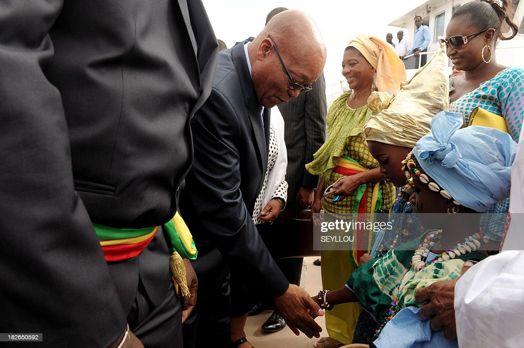 South African President Jacob Zuma meets with residents of Goree Island, off Dakar, on October 2, 2013. The island of Goree, four kms (about two miles) off Dakar, processed many of the estimated 12 million Africans who over three centuries crossed the Atlantic Ocean bound in chains, their lives and liberty traded in the US slave market.