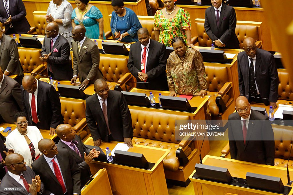 South African President Jacob Zuma (R) prepares to give his state of the nation address in Cape Town, South Africa, on February 11, 2016. South Africa's radical leftist Economic Freedom Fighters (EFF) party walked out of President Jacob Zuma's state of the nation address Thursday after repeatedly interrupting his speech in chaotic parliamentary scenes. / AFP / AP / Schalk van Zuydam