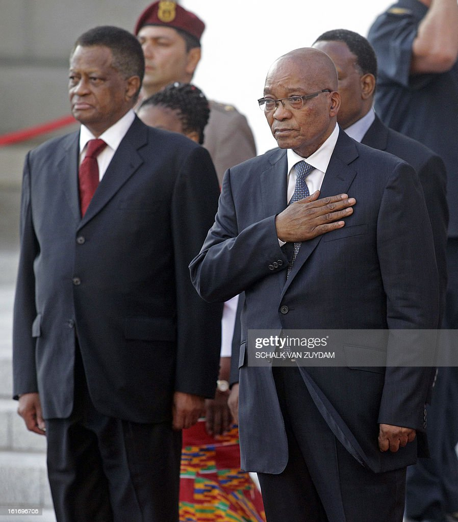 South African president Jacob Zuma, right, watches a guard of honour forming part of the Parliament opening in the city of Cape Town, South Africa, on February 14, 2013.