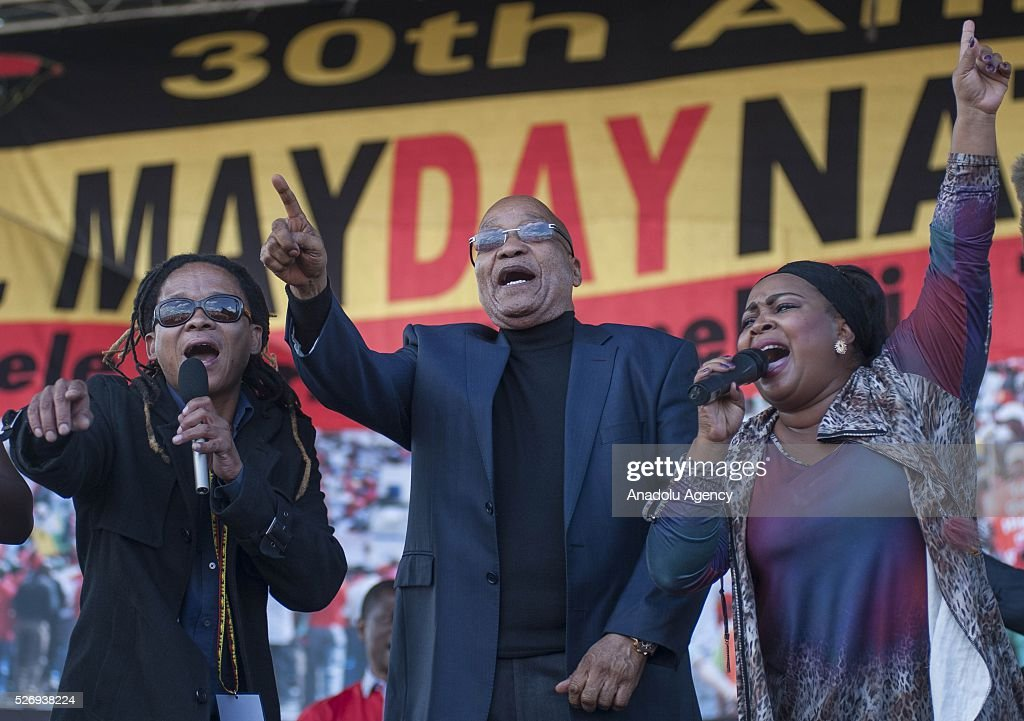South African President Jacob Zuma (C) salutes citizens as workers, organized by the Congress of South African Trade Unions (COSATU) and African National Congress (ANC) take part in a rally to mark May Day, International Workers' Day at Morelete Park in Pretoria, South Africa on May 01, 2016. Every year May Day is observed and commemorated all around South Africa.