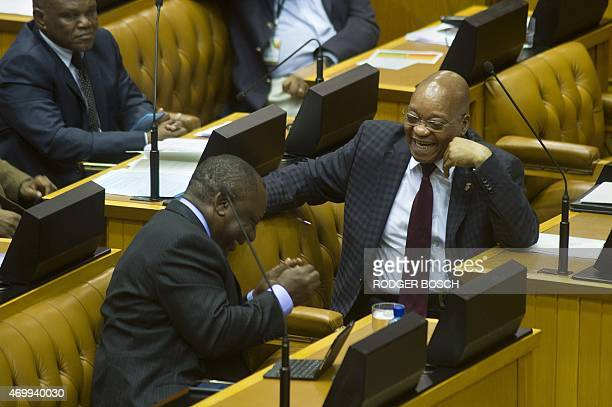 South African President Jacob Zuma shares a laugh with Deputy President Cyril Ramaphosa during a session at the South African Parliament on April 16...