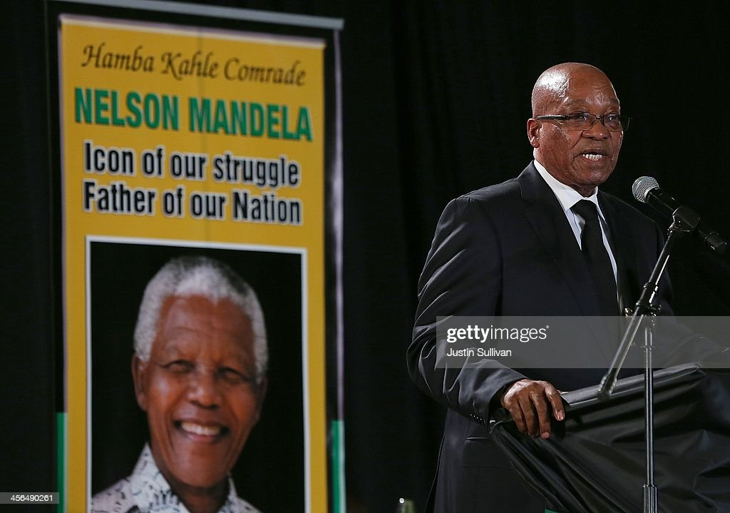 South African president <a gi-track='captionPersonalityLinkClicked' href=/galleries/search?phrase=Jacob+Zuma&family=editorial&specificpeople=564982 ng-click='$event.stopPropagation()'>Jacob Zuma</a> speaks during an African National Congress (ANC) led alliance send off ceremony at Waterkloof military airbase on December 14, 2013 in Pretoria, South Africa. The ANC held an official send off ceremony as the body of former South African President prepares to make one final journey to his hometown of Qunu for burial. Mr. Mandela passed away on the evening of December 5, 2013 at his home in Houghton at the age of 95. Mandela became South Africa's first black president in 1994 after spending 27 years in jail for his activism against apartheid in a racially-divided South Africa.