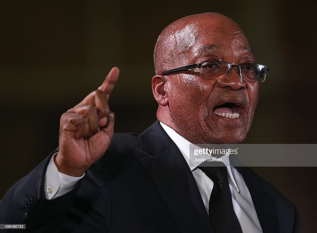 South African president Jacob Zuma speaks during an African National Congress (ANC) led alliance send off ceremony at Waterkloof military airbase on December 14, 2013 in Pretoria, South Africa. The ANC held an official send off ceremony as the body of former South African President prepares to make one final journey to his hometown of Qunu for burial. Mr. Mandela passed away on the evening of December 5, 2013 at his home in Houghton at the age of 95. Mandela became South Africa's first black president in 1994 after spending 27 years in jail for his activism against apartheid in a racially-divided South Africa.