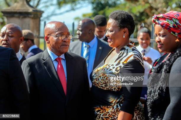 South African President Jacob Zuma speaks with relatives of late Chief Albert Luthuli during a commemoration under theme of unity in action marking...