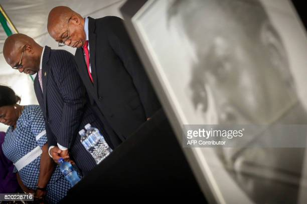 South African President Jacob Zuma stands next to a portrait of late Chief Albert Luthuli during a commemoration under theme of unity in action...