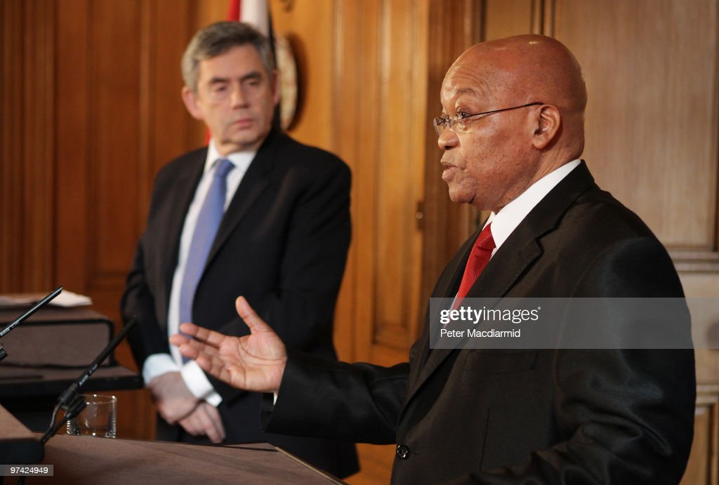 South African President Jacob Zuma (R) talks to reporters as Prime Minister Gordon Brown looks on inside Number 10 Downing Street on March 4, 2010 in London, England. President Zuma and his wife are visiting the United Kingdom on a three-day state visit.