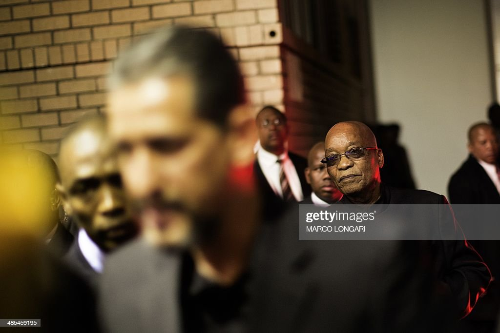 South African President Jacob Zuma walks in the player's tunnel as he leaves the Ellis Park stadium in Johannesburg April 18, 2014 after having attended a Good Friday service with the Universal Church of the Kingdom of God. LONGARI