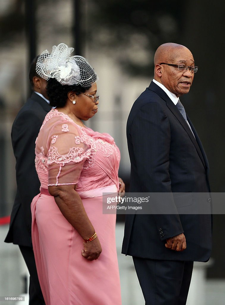 South African President Jacob Zuma (R) with one of his wives attends the opening of parliament in Cape Town, South Africa, on February 14, 2013. During the opening of parliament 2013Zuma delivers his State of the Nation address where he outlines the government's programme of action for the year.