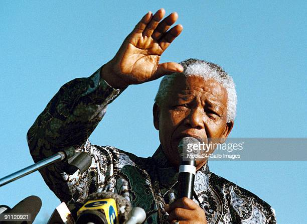 South African president Nelson Mandela addresses the crowd at the Hector Petersen memorial in Soweto on Youth Day 16 Junie 1999 South Africa