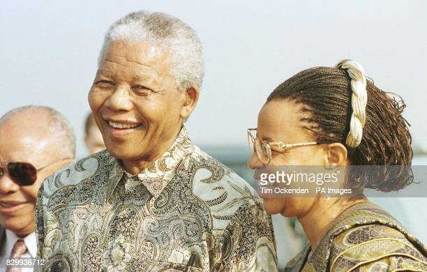 South African President Nelson Mandela arrived at Heathrow airport with the woman who has replaced his exwife Winnie grinning at suggestions he was...