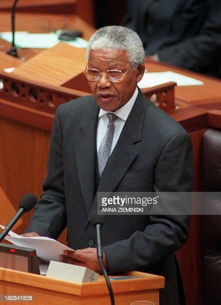 South African President Nelson Mandela delivers his final address to a joint sitting of both houses in Parliament Cape Town 26 March 1999 Mandela's...