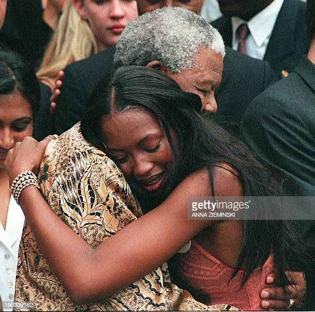 South African President Nelson Mandela hugs British supermodel Naomi Campbell at Genadendal his Cape Town home 13 February Campbell has brought the...