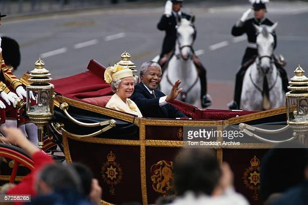 South African President Nelson Mandela pictured with her Majesty Queen Elizabeth II during his state visit to Great Britain in 1996
