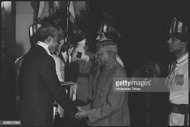 South African President Nelson Mandela receiving the Bharat Ratna Award from Indian President on October 16 1990 in New Delhi India Revered icon of...