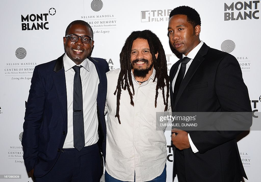 South African president Nelson Mandela's grandsons, Kweku Mandela (L) and Ndaba Mandela (R) pose with reggae legend Bob Marley 's son Rohan Marley during a party for 'Power of Words: Nelson Mandela', a celebration of filmmaking inspired by the meaning behind the words and quotes of Nelson Mandela, during the 2013 Tribeca Film Festival in New York, April 19, 2013. AFP PHOTO/Emmanuel Dunand