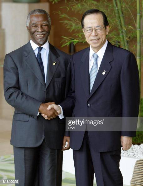South African President Thabo Mbeki and Japanese Prime Minister Yasuo Fukuda shake hands at the Outreach working lunch on July 7 2008 in Toyako Japan...