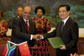South African Prime Minister Jacob Zuma shakes hands with Chinese President Hu Jintao at a signing ceremony at the Great Hall of the People on August...
