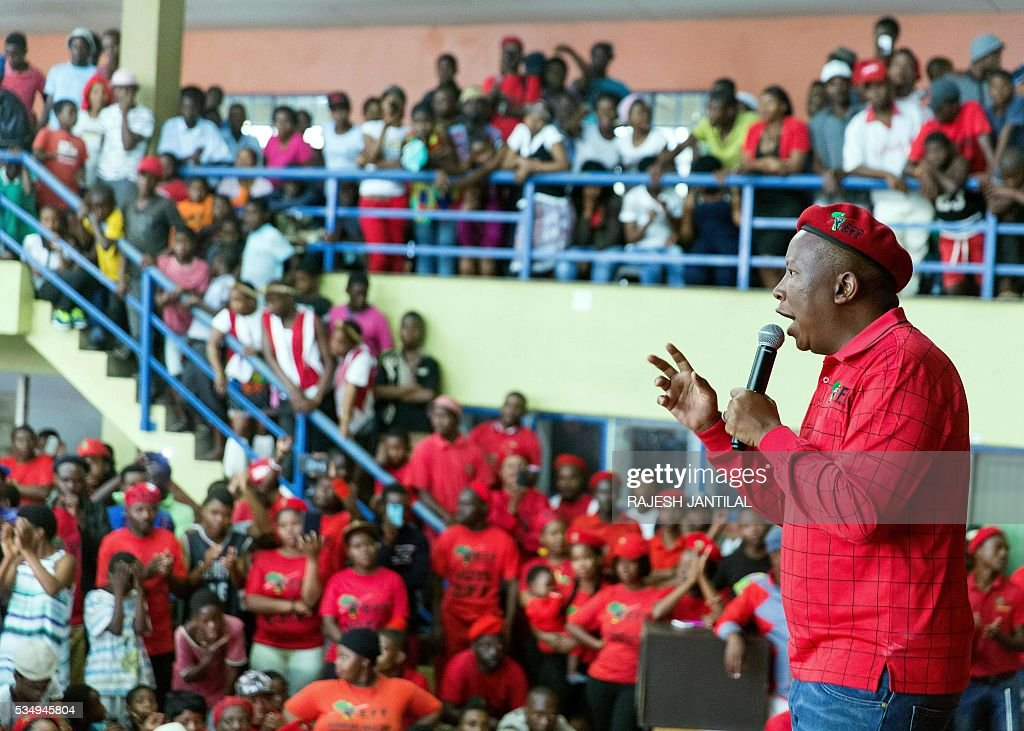 South African radical leftist opposition party Economic Freedom Fighters leader Julius Malema (C) addresses supporters during a municipal election campaign rally at the Chief Albert Luthuli centre on May 28, 2016 in Groutville, south of Durban, South Africa. / AFP / RAJESH
