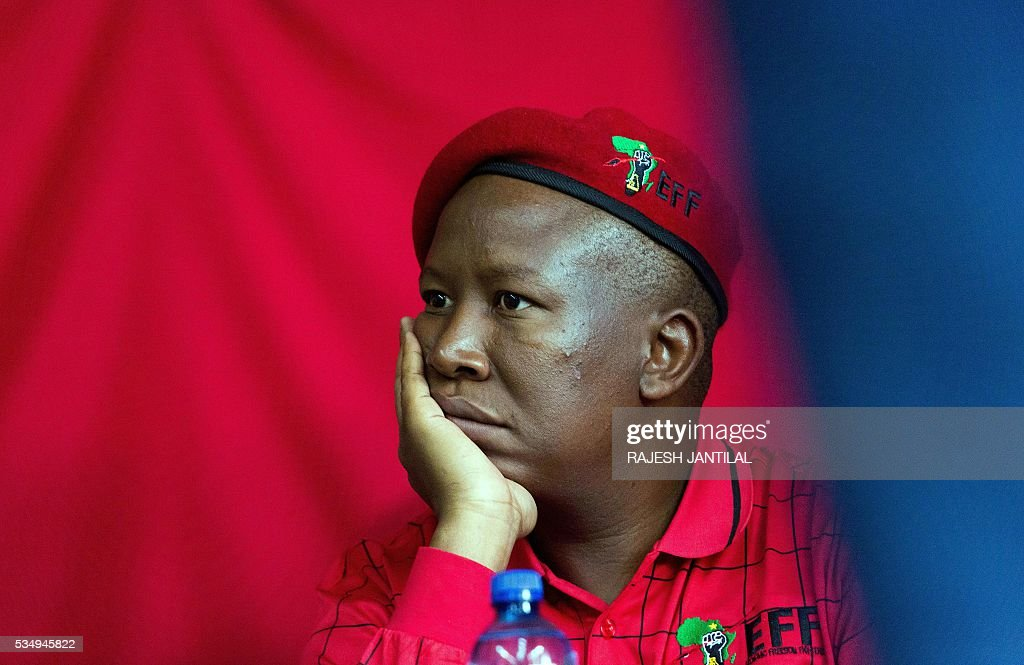 South African radical leftist opposition party Economic Freedom Fighters leader Julius Malema waits to address supporters during a municipal election campaign rally at the Chief Albert Luthuli centre on May 28, 2016 in Groutville, south of Durban, South Africa. / AFP / RAJESH