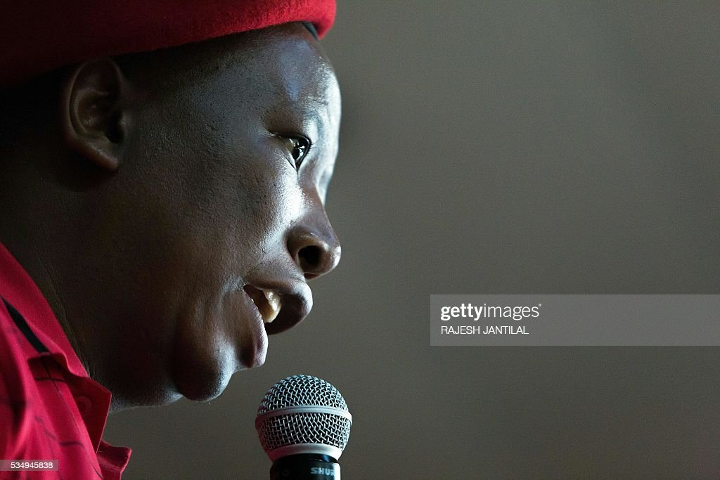 South African radical leftist opposition party Economic Freedom Fighters leader Julius Malema addresses supporters during a municipal election campaign rally at the Chief Albert Luthuli centre on May 28, 2016 in Groutville, south of Durban, South Africa. / AFP / RAJESH