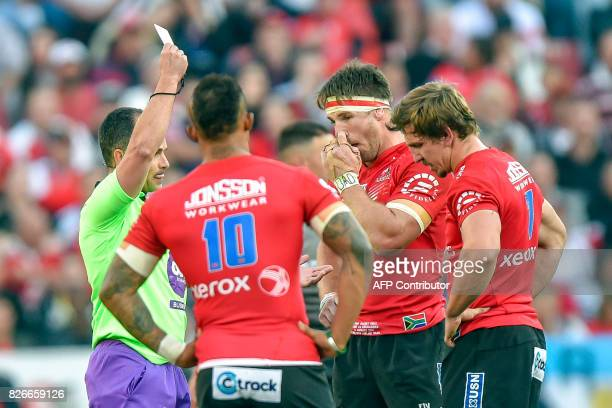 South African referee Jaco Peyper gives a Red card to Lions's South Africam Kwagga Smith during the Super XV rugby final match between Lions and...