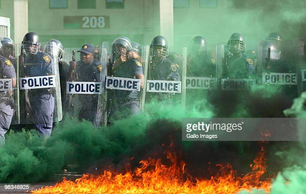 South African riot police take part in a simulated riot exercise on April 8 2010 in Port Elizabeth South Africa The riot police undertook the mock...