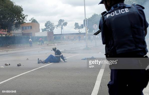 TOPSHOT South African riot policemen fire rubber bullets to disperse Somali and foreign nationals clashing with South African nationals during a...